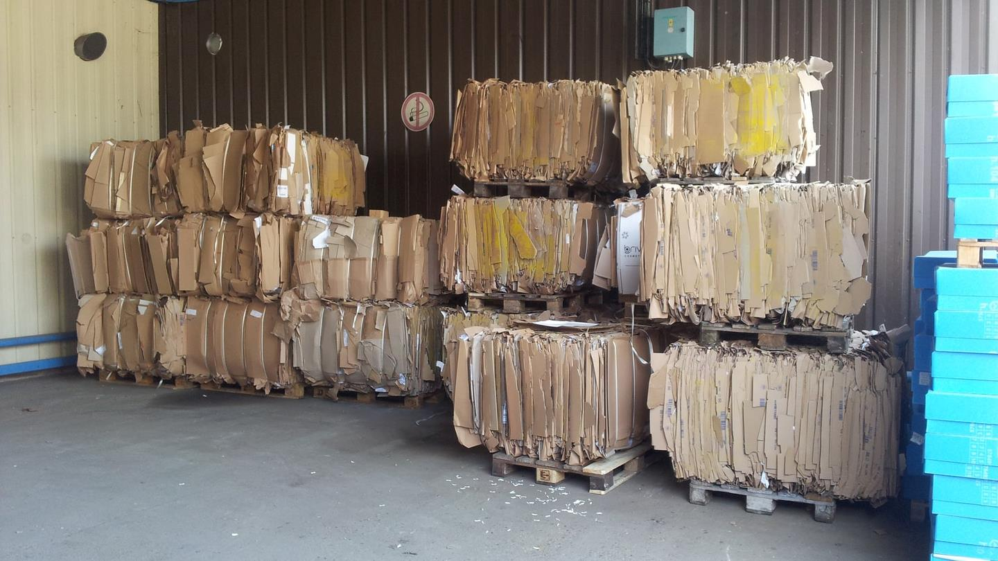 Cardboard bales stacked until collection in Cosmeva warehouse