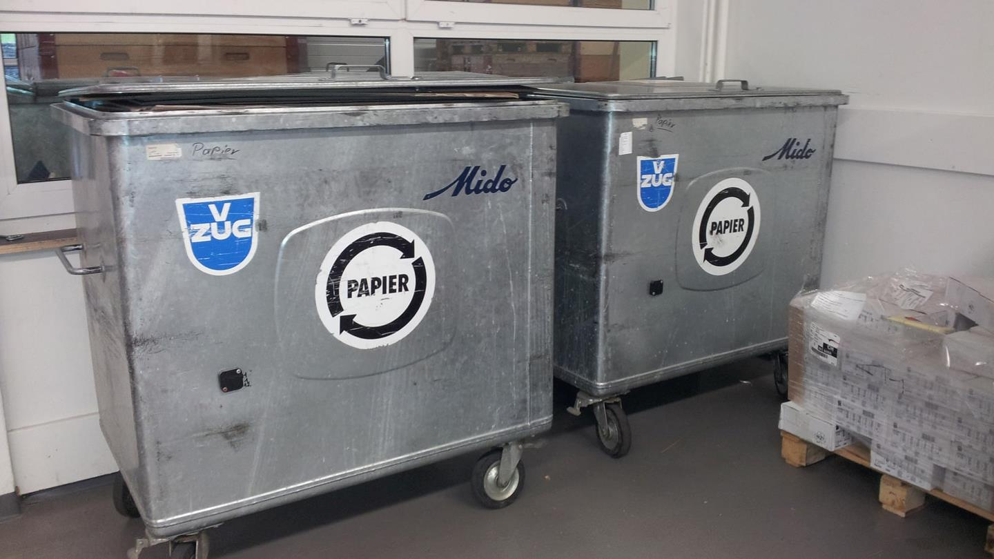 Two metal containers for recyclable paper waste